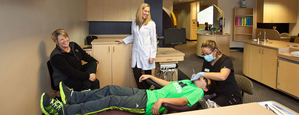 Dr. Emi and her staff working on a patient in their Everett Orthodontist Office